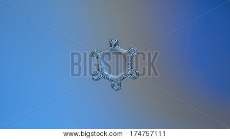 Macro photo of real snowflake: small snow crystal of star plate type with six tiny arms and big, flat central hexagon, containing unusual pattern of tiny dots, sparkling on pale blue gradient background. This is horizontal version with cinematic proportio