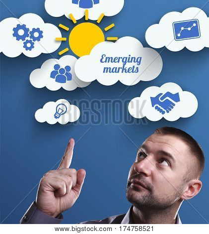 Business, Technology, Internet And Marketing. Young Businessman Thinking About: Emerging Markets