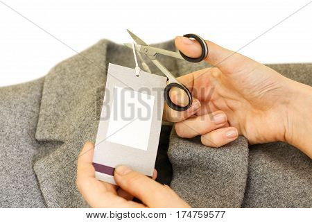 Girl Hands Removing Cutting Label Board Price Tag Off Grey Wool Coat With Scissors. Female After Sho