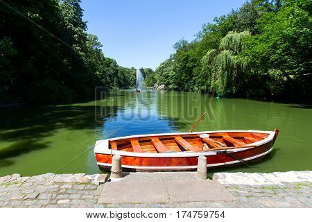 Boat in the lake the park Uman. fountain in the lake can be seen. Summer sunny day