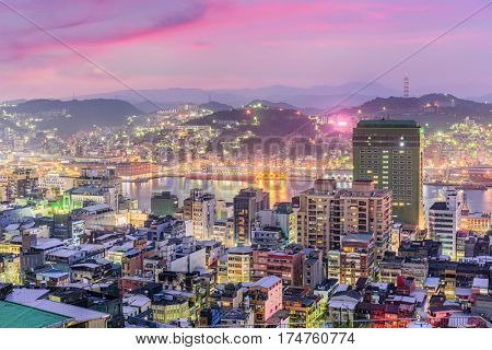 Keelung, Taiwan skyline at twilight towards the port.