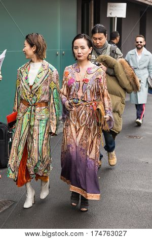 MILAN ITALY - FEBRUARY 24: Fashionable woman poses outside Etro fashion show during Milan Women's Fashion Week on FEBRUARY 24 2017 in Milan.