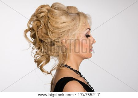 Profile of young blonde girl with fashionable hairstyle