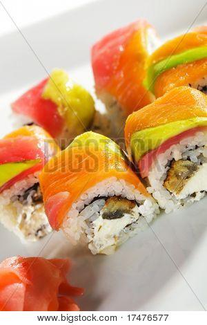 Rainbow Roll - Eel and Cream Cheese inside. Tuna, Salmon and Avocado outside