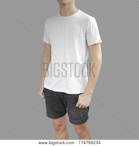 White T Shirt And Black Shorts On A Young Man Template On Grey Background.