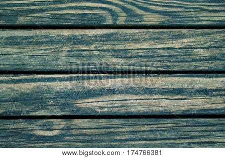 Green wood planks photo background. Rough timber table texture. Warm brown wooden backdrop for shabby chic design. Timber texture closeup. Rustic wooden table wallpaper or banner template