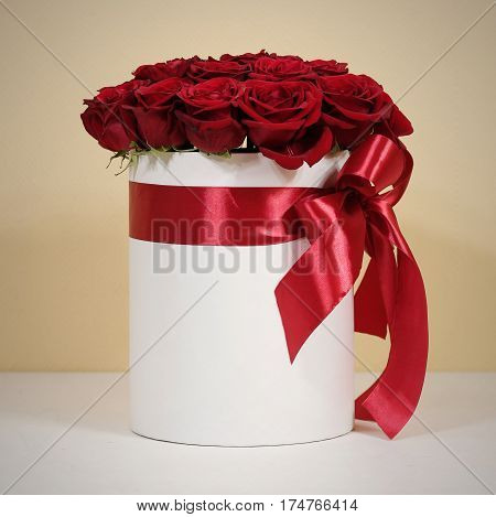 Rich Gift Bouquet Of 21 Red Roses. Composition Of Flowers In A White Hatbox. Tied With Wide Red Ribb