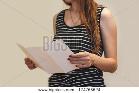 Girl Reading Blank White Flyer Brochure Booklet. Leaflet Presentation. Pamphlet Hold Hands. Woman Sh