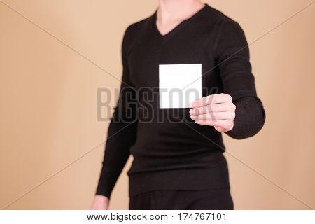 Man Showing Blank White Square Flyer Brochure Booklet. Leaflet Presentation. Pamphlet Hold Hands. Ma