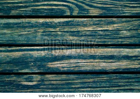 Green toned wood planks photo background. Rough timber table texture. Warm brown wooden backdrop for shabby chic design. Timber texture closeup. Rustic wooden table wallpaper or banner template