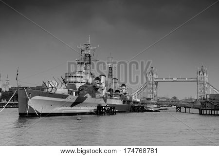 HMS Belfast warship and Tower Bridge in Thames River in London