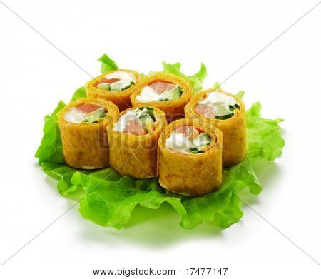 Mexico Maki Sushi - Roll made of Smoked Salmon, Cream Cheese, Cucumber and Spring Onion inside. Mexican Pancake ouside. Served on Salad Leaf