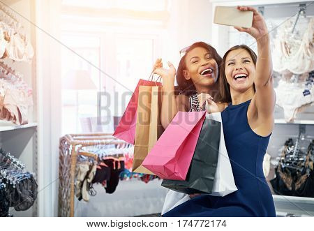 Two Vivacious Fun Loving Young Women Shoppers