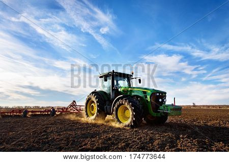Varna Bulgaria - March 5 2017 Ploughing a field with John Deere 6930 tractor. John Deere was manufactured in 1995-1999 and it has JD 7.6L or 8.1L 6-cyl diesel engine.