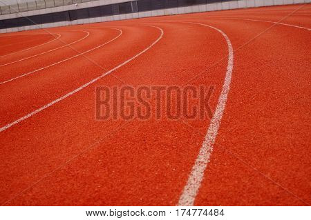 Red plastic track and field runway, This is a close-up.