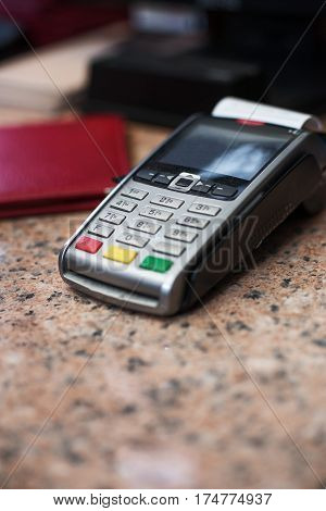 Close Up Of Credit Card Reader And Cash Register On Background Of Retail Shelves