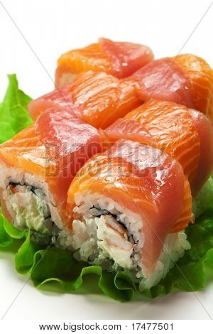 Salmon and Tuna Maki Sushi - Roll made of Cream Cheese and Shrimp (ebi) inside. Fresh Salmon and Tuna outside. Served pn Salad Leaf