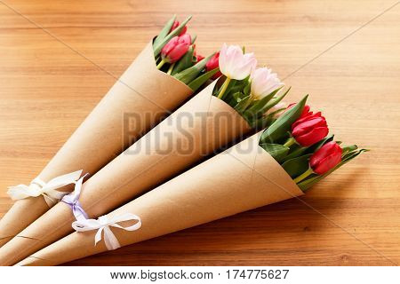 Red And White Tulips On A Wooden Background