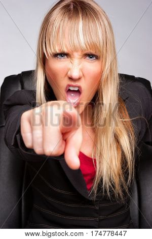 Angry yelling business woman pointing