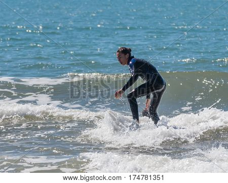 Young Man Exercising In Surfing On The Board