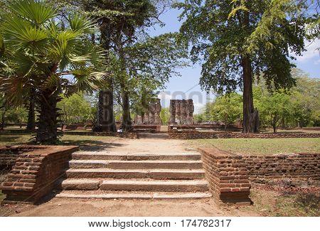 Royal Palace Polonnaruwa or Pulattipura ancient city of the Kingdom of Polonnaruwa in Sri Lanka with green trees and palms