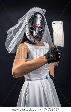 Bride in hockey mask with meat cleaver
