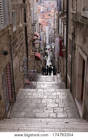 DUBROVNIK, CROATIA - NOVEMBER 30: Narrow street inside Dubrovnik old town, Croatia on November 30, 2015.