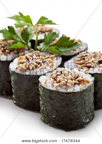 Unagi Maki - Smoked Eel Sushi Roll. Topped with Eel Sauce and Sesame. Served with Parsley