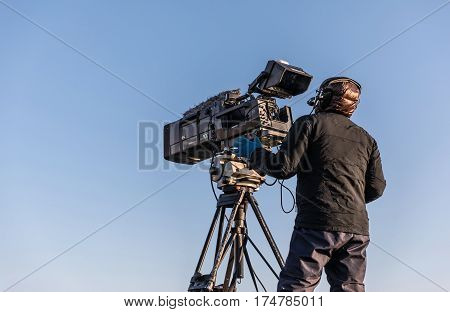 Cameraman filming sailing race live for the television