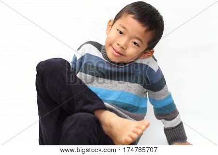 Japanese Boy Sitting On The Floor (first Grade At Elementary School)