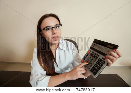Smiling female bookkeeper has reduced balance
