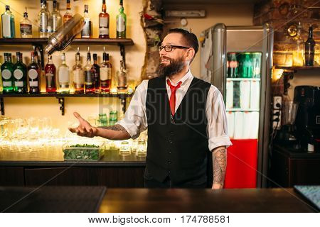 Bartender with shaker show professional trick