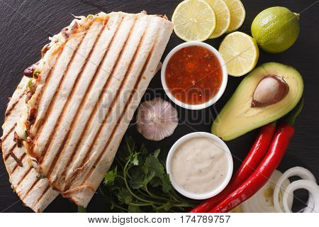 Quesadilla With Minced Beef, Beans, Avocado And Cheese Close-up. Horizontal Top View