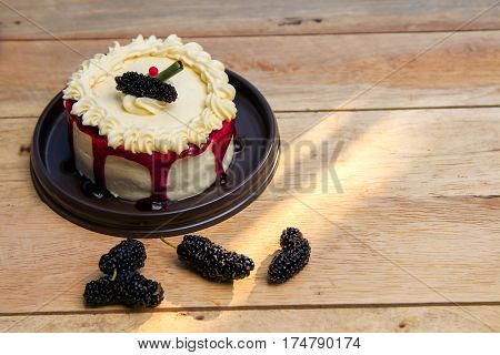 vanilla cake with mulberry on wood background  ,Delicious dessert homemade with berry.