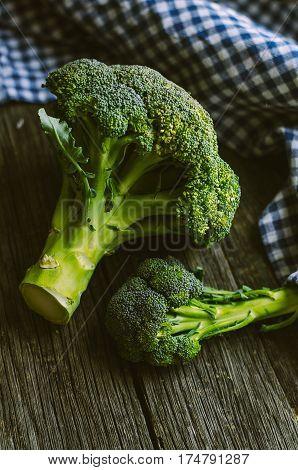 Broccoli. Raw fresh broccoli on old wooden table.