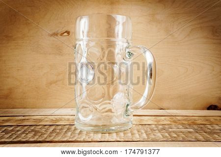 large empty pint of beer on old wooden table