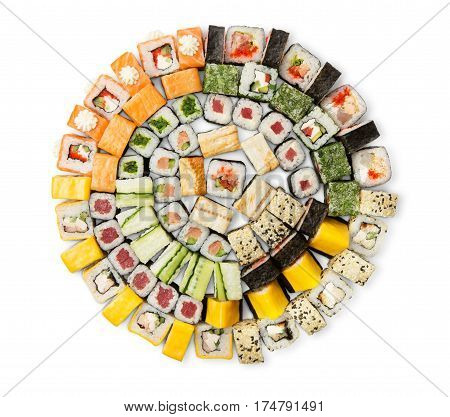 Sushi big party platter isolated on white background. Japanese food restaurant delivery - maki, unagi and california rolls set placed in circle, top view