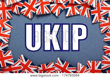 The word UKIP which stands for United Kingdom Independence Party with a border of union jack flags