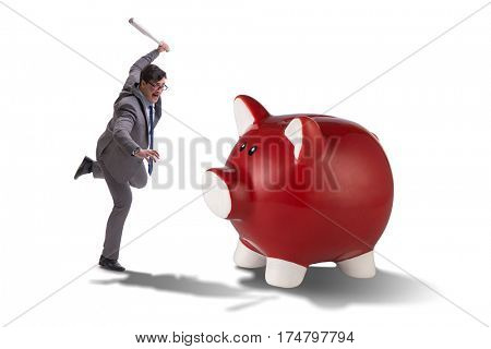 Angry man with baseball bat hitting piggybank