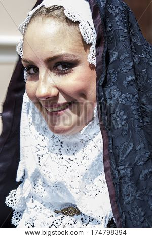 CAGLIARI, ITALY - May 1, 2014: 358 Religious Procession of Sant'Efisio - portrait of a beautiful smiling girl in traditional Sardinian costume - Sardinia
