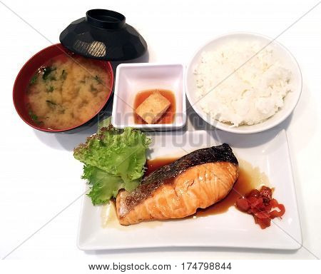 Fried Salmon On The Rice Served With Preserved Cucumber And Sour Sauce