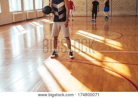 Low angle shot of a man playing basketball.