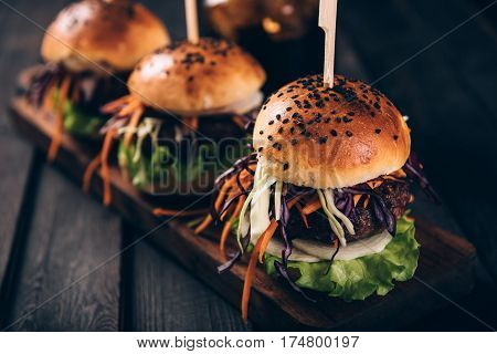 Delicious Homemade hamburgers with fresh vegetables. VIntage toned.