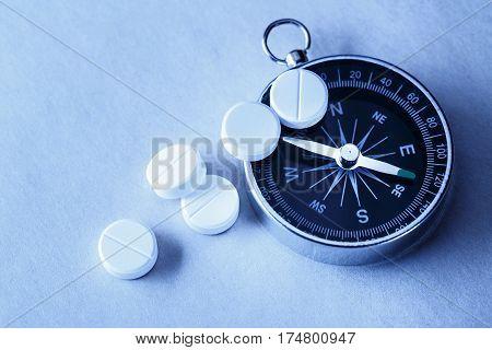 White Aspirin Pills And Compass