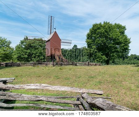 An scenic old windmill on a farm.