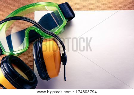 Earphones, Goggles And Blank Paper