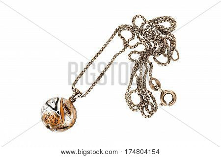 Golden ball pendant on a chain on white background