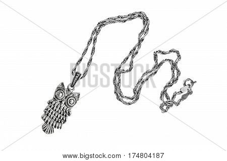 Silver pendant in the form of owl on a chain isolated over white