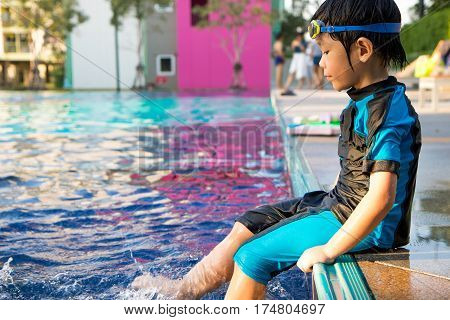boy learn to swim in the swimming pool