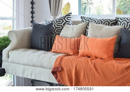 Modern Living Room Design With Brown And Orange Tweed Sofa And Black Pillows